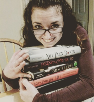 Devouring Books Mandy Hugging her books
